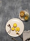 Lemon custard tartlets and candied lemons (seen from above)