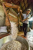 A man making palm sugar-rice sweets (Cai Be, Vietnam, Indochina, Southeast Asia)