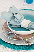 A place setting with a fabric napkin in a napkin ring