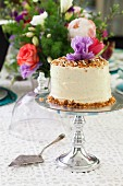 Carrot cake with pineapple, macadamia nuts and cream cheese