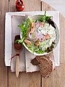 Cucumber and salmon salad with onions and bread