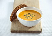 Pumpkin soup with pumpkin seeds and grilled bread