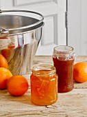 Homemade marmalade with peel, and blood orange marmalade