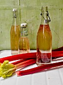Homemade rhubarb syrup in flip-top bottles