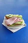 A lettuce, ham and cucumber sandwich