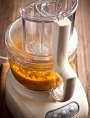 Pumpkin soup: pumpkin being puréed in a mixer