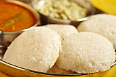 Idli (rice cakes with sambar soup and coconut chutney, South India)