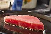 Tuna steak searing on a comal (a Latin American flat grill)