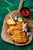 Coconut-coated chicken escalope