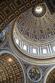 The imposing dome painted by Michelangelo in St Peter's Cathedral, Rome