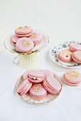 Pink macaroons filled with raspberry jam and clotted cream