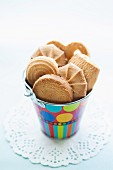 Various biscuits in a colourful bucket