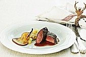 Saddle of venison with pear risotto