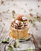 A hedgehog cupcake with chocolate coffee cream
