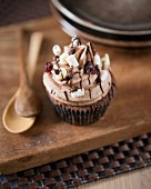 A Rocky Road cupcake with cranberries and chocolate chips