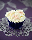 A white chocolate pansy cupcake