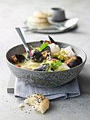 Diced cod with mussels in a coconut and lemongrass broth with unleavened bread