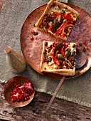 Oriental tart with pomegranate seeds and caper fruits