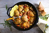 Chicken thighs with lemons, garlic and tomatoes (seen from above)