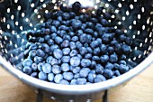Fresh blueberries in a colander