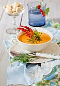 Luxurious lobster soup with oyster crackers