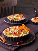 Mini quiche with yellow beets, leek, orange and pomegranate seeds