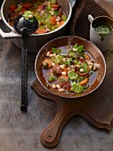 Savoy cabbage stew with white beans and smoked almond pesto