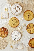Lattice biscuits, some with icing sugar