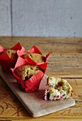 Raspberry muffins in red paper cases