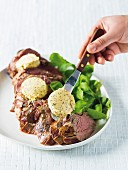 Roast beef fillet with rosemary and mustard butter