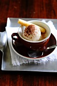 Espresso affogato with a scoop of vanilla ice cream and a wafer