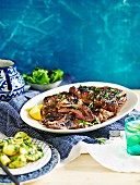 Butterflied lamb with lemony herb potatoes
