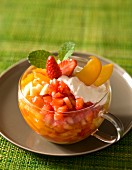 Summer fruit salad with strawberries, peaches and bananas