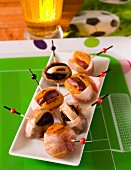 Plum and apricot skewers wrapped in bacon