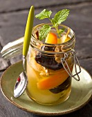 Autumnal fruit compote with walnuts and verbena