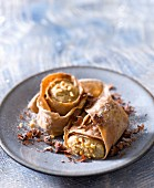 Pancake rolls filled with peanut and cocoa