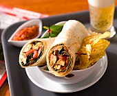 Chicken wrap with spinach and tomatoes