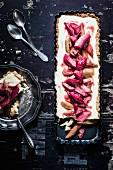 Rhubarb tart with vanilla cream, sliced