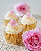 Vanilla cupcakes with pink fondant flowers