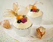 Cupcakes with blueberries, kiwis, raspberries and physalis