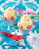 Cupcakes with colourful chocolate beans and sugar sprinkles