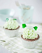 Chocolate cupcakes with mint frosting and mint sweets