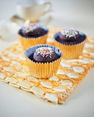 Dark chocolate cupcakes with colourful sugar sprinkles