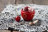 A bowl of homemade cherry ice cream