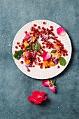 Orange and pomegranate salad with rose petals, mint and grated coconut