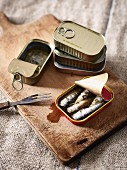 Sardines in oil on a chopping board
