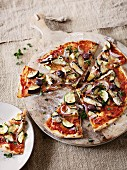 Vegetable pizza with courgettes and sardines in oil