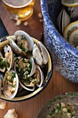 Steamed clams in a white wine broth with garlic and herbs