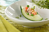 A cucumber boat with tuna fish salad