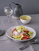 Cheese and sausage salad with tomatoes and vinaigrette